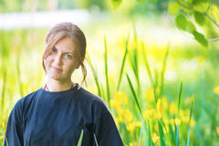 Pretty woman on the green field Stock Image