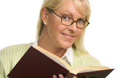 Pretty Woman Grins While Reading a Book Stock Images