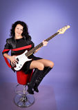 Pretty woman with guitar Stock Image