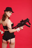 Pretty woman with gun Royalty Free Stock Images