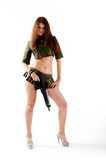 Pretty woman with a gun Stock Image