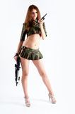 Pretty woman with a gun Stock Images