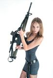 Pretty woman with gun. Attractive sexy blond woman holding army rifle Royalty Free Stock Image