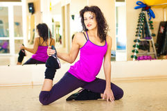 Pretty woman in gym. Beautiful woman get exesize in fitness club stock photography
