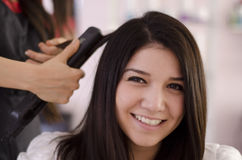 Pretty woman in a hair salon Royalty Free Stock Images