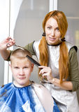 Pretty woman hairdresser Royalty Free Stock Images