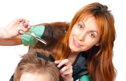 Pretty woman hairdresser cuts client Stock Images
