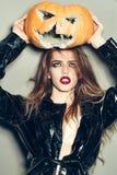 Pretty woman with halloween pumpkin Stock Photos