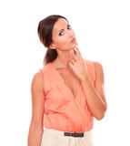 Pretty woman with hand on chin wondering Royalty Free Stock Photo