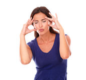 Pretty woman with hand on head and closed eyes Stock Images
