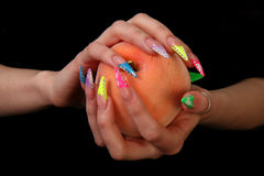 Pretty woman hand with perfect painted nails  on black background Stock Photos