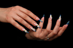 Pretty woman hand with perfect painted nails isolated on black background Royalty Free Stock Photos