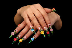 Pretty woman hand with perfect painted nails isolated on black background Royalty Free Stock Photography
