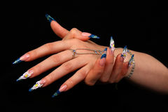 Pretty woman hand with perfect painted nails isolated on black background Stock Photos