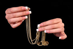 Pretty woman hand with perfect painted nails isolated on black background Royalty Free Stock Photo