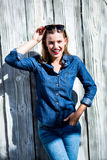 Pretty woman with hand in pocket Stock Photos