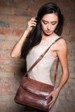 Pretty woman with handbag Royalty Free Stock Photo