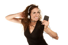Pretty woman with handheld audio device Royalty Free Stock Photo