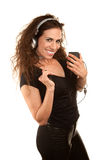 Pretty woman with handheld audio device Stock Photography