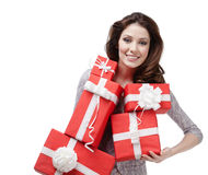 Pretty woman hands a great amount of gift boxes Royalty Free Stock Photo