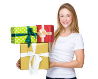 Pretty woman hands many presents Royalty Free Stock Images