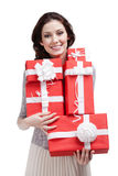 Pretty woman hands a number of gift boxes Royalty Free Stock Photography
