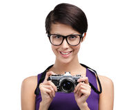 Pretty woman hands retro photographic camera Stock Photos