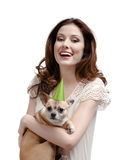 Pretty woman hands a straw-colored small pet Stock Photography