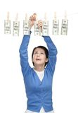 Pretty woman hangs money on the line Stock Photography