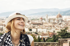 Pretty woman happily laughs with the city of Florence behind her Royalty Free Stock Image