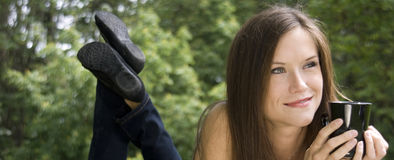 Pretty Woman Has Coffee In The Park Royalty Free Stock Photography