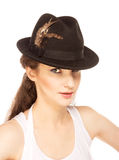 Pretty woman in hat with bird's feather. Isolated Stock Photography