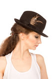 Pretty woman in hat with bird's feather. Isolated Royalty Free Stock Photos