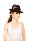 Pretty woman in hat with bird's feather Royalty Free Stock Photos