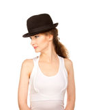 Pretty woman in hat with bird's feather. Isolated Stock Image
