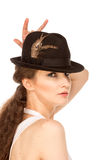 Pretty woman in hat with bird's feather. Isolated Royalty Free Stock Images