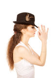 Pretty woman in hat with bird's feather. Isolated Stock Images