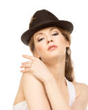 Pretty woman in hat with bird's feather. Isolated Royalty Free Stock Photo