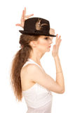 Pretty woman in hat with bird's feather. Isolated Royalty Free Stock Photography