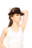 Pretty woman in hat with bird's feather Royalty Free Stock Photo