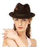 Pretty woman in hat with bird's feather Royalty Free Stock Photography
