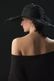 Pretty woman with a  hat on her head. Portrait of a young sexy woman with a  hat on her head Royalty Free Stock Images