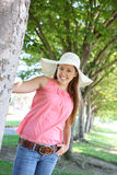 Pretty Woman with Hat in Park Royalty Free Stock Photos