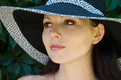Pretty woman in hat portrait Stock Image