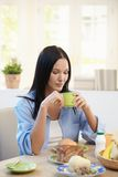 Pretty woman having breakfast Stock Images