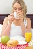 Pretty woman having breakfast. Royalty Free Stock Photo