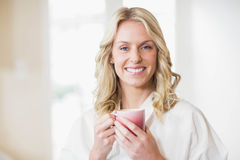 Pretty woman having a cup of coffee. In the kitchen Royalty Free Stock Images