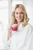 Pretty woman having a cup of coffee. In the kitchen Royalty Free Stock Photography