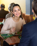 Pretty woman having dinner with a man in a restaurant Royalty Free Stock Image
