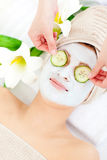 Pretty woman having a face mask Royalty Free Stock Photos